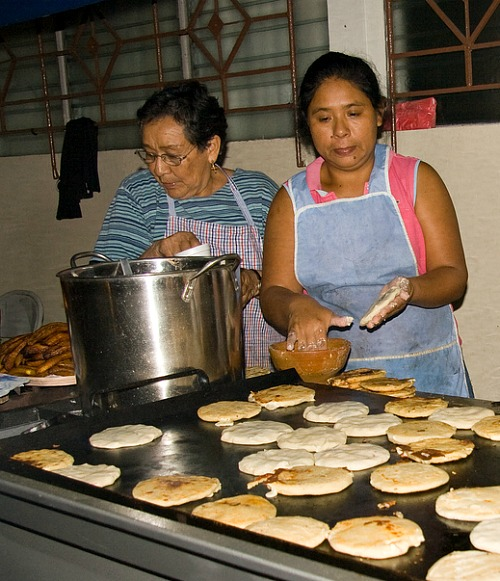 women making pupusas