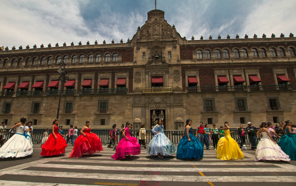 Quinceañeras in colorful dresses parade past Mexico City's Palacio Nacional 2012 / Image source: Javier Hidalgo
