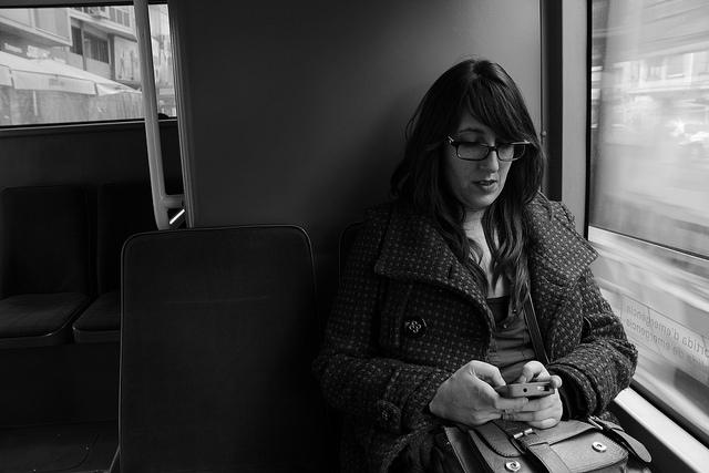 woman texting by Jose Antonio Sánchez